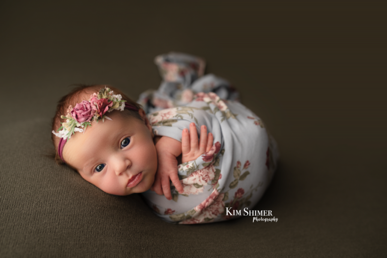 newborn girl with blue floral wrap